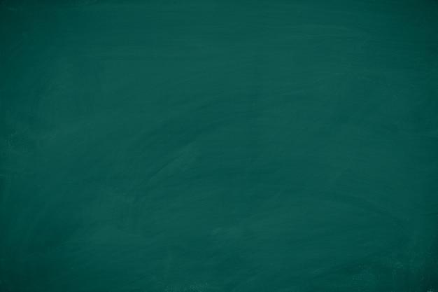 緑の黒板。背景のチョークテクスチャ教育委員会の表示。