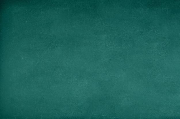 緑色のチョークボードチョークのテクスチャトレースが学校のディスプレイを消した。