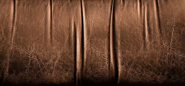 茶色の革の質感のクローズアップ。作業デザインとグラフィックの革背景を色します。