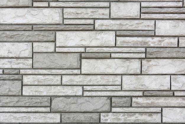 モダンな白とグレーの色の石の壁のテクスチャを背景に閉じる