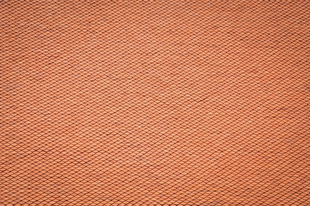 Тайский старый стиль дизайн на крыше, слой красной глины плитки крыша текстуры фона