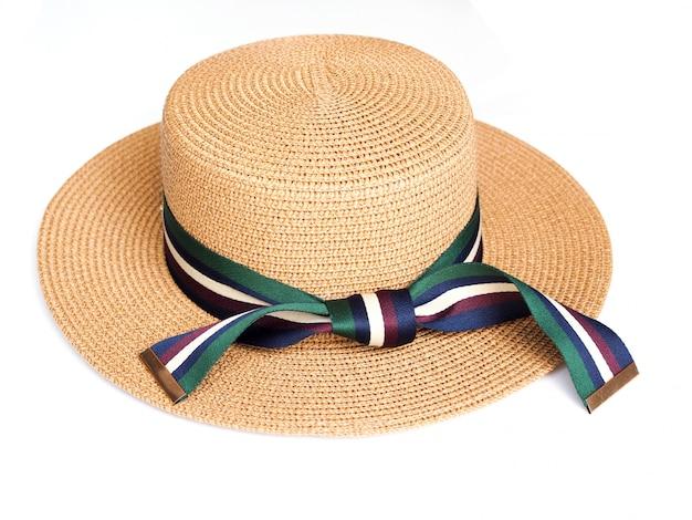 Над шляпой женщин стиля моды изолированной на белой поверхности.