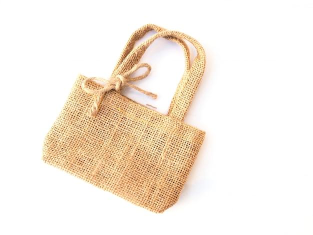Мешок, изолированные на белой поверхности, традиционная сумка ручной работы с вретище.