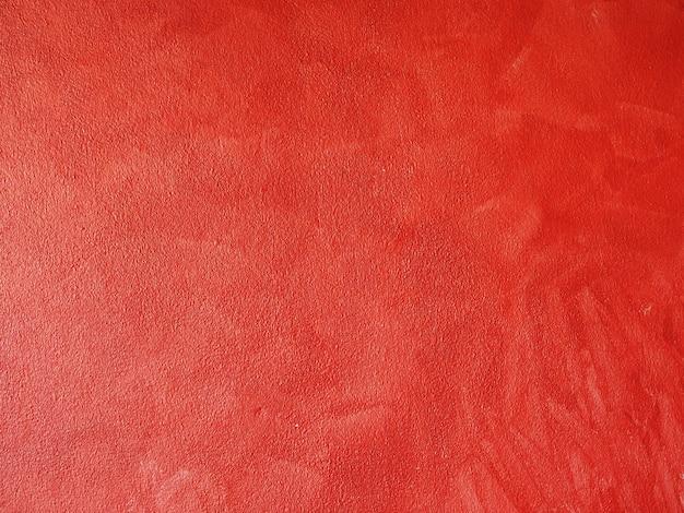 赤いセメントの壁と抽象的な表面。