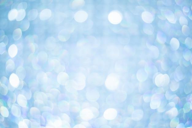 抽象的な背景、ボケ味がぼやけて美しい光沢のあるライト