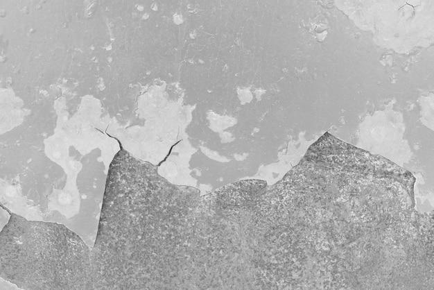 ビンテージ背景テクスチャ古い石積み石レンガの亀裂を持つ古代のセメント