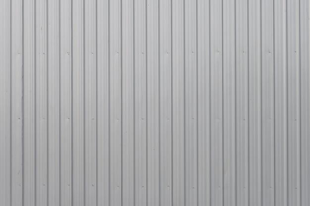 灰色の織り目加工のアルミニウムシート、灰色の電流を通された鉄の壁のテクスチャ背景