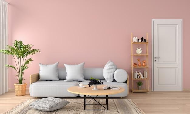 ソフトピンクのリビングルームにあるグレーのソファと枕