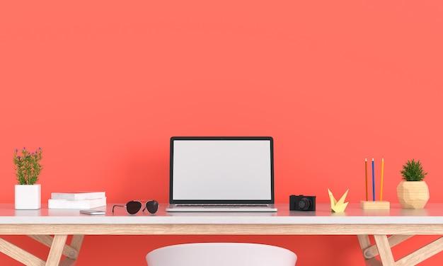 オレンジ色の部屋のテーブルの上のモックアップのためのノートパソコンの表示