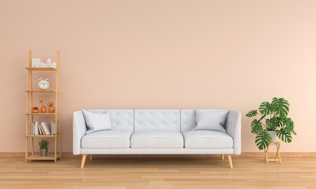 灰色のソファーと茶色のリビングルームの緑の植物