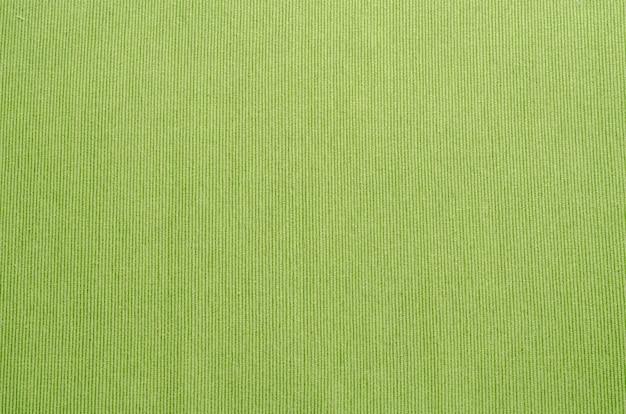 緑のテーブルクロスの質感のクローズアップテクスチャ背景