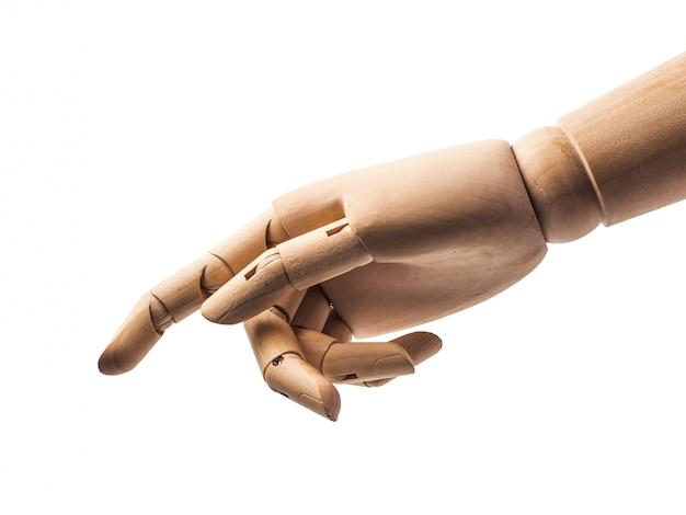 木の人形の手は白に触れる指を作る