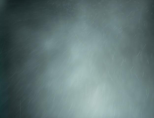 暗い背景に抽象的な灰色の煙の照明とほこり