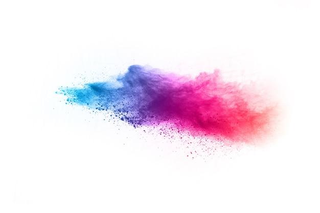 抽象的な粉スプラット背景。白い背景にカラフルな粉の爆発。