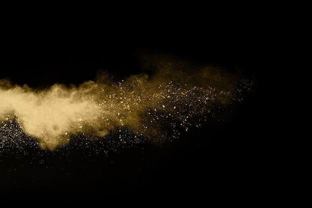 黒い背景に金粉の爆発。動きを止める