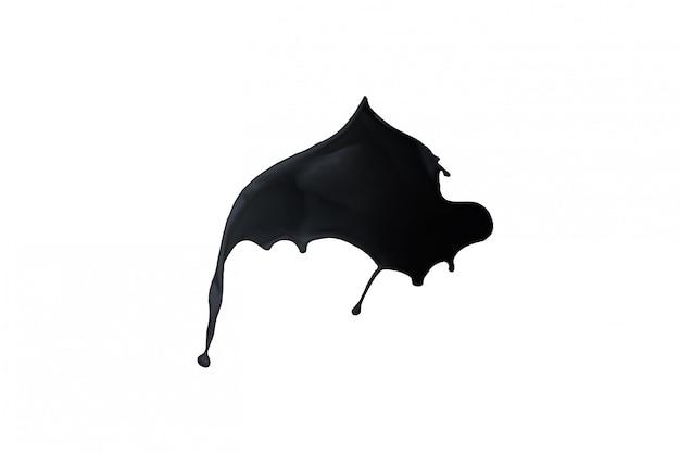 黒いペンキのしぶきが白い背景で隔離。