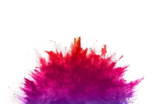 Абстрактный порошок забрызгал. красочный взрыв порошка на белизне.