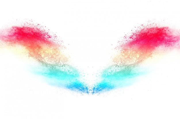 Красочный взрыв порошка на белой предпосылке.