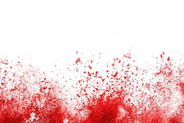 赤い粉の爆発、白い背景で隔離の動きを凍結します。