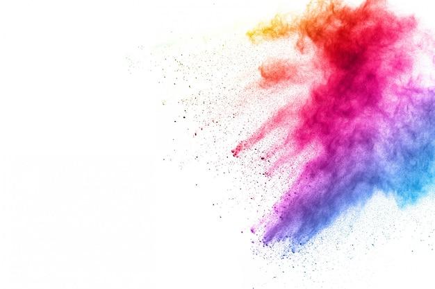 抽象的なパウダー飛び散った背景。白地にカラフルな粉体爆発。