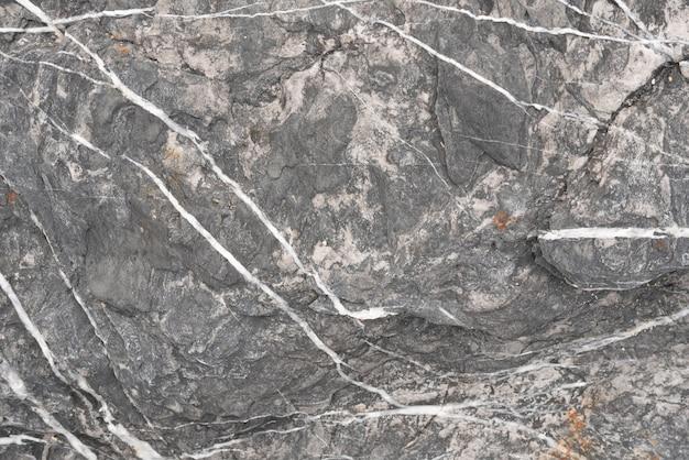 黒い石と白い線の背景と質感