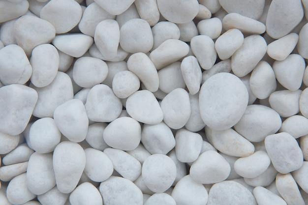 白い砂利の背景。