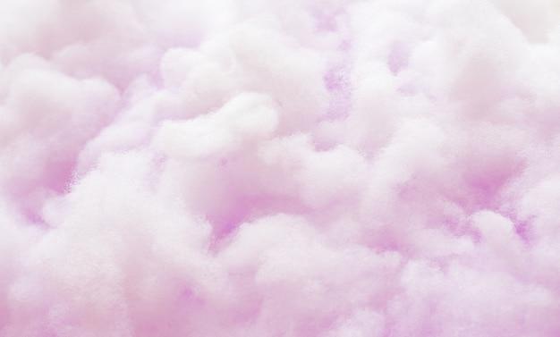 カラフルな紫色のふわふわした綿のキャンデーの背景、柔らかい色の甘いキャンディーフロス