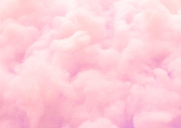 カラフルなピンクのふわふわした綿のキャンデーの背景、柔らかい色の甘いキャンディーフロス、抽象的なぼかし