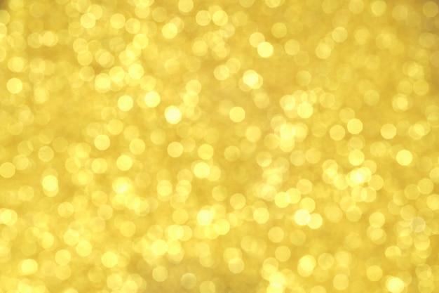テクスチャの抽象的な背景のキラキラのゴールドとエレガント