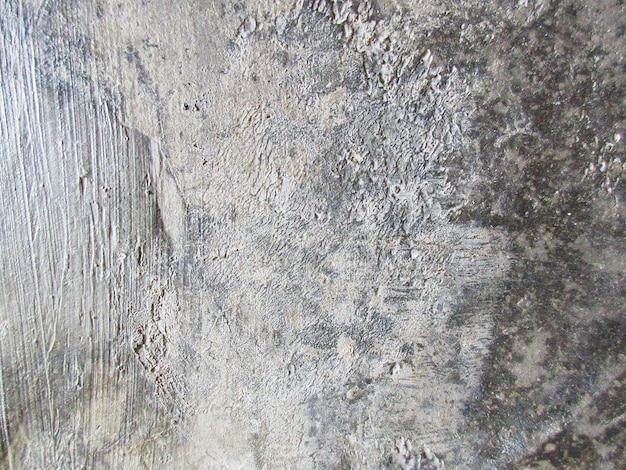 灰色の壁の天然の不均一セメントテクスチャ背景