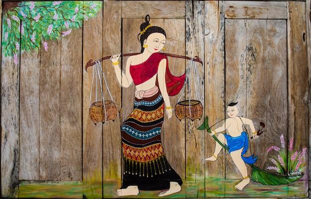 タイの女性と子供のウィンドウで絵