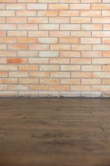 テクスチャの茶色のレンガと木製の床の背景
