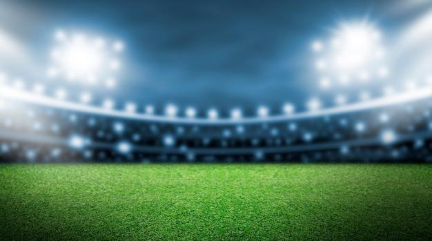 スタジアムのサッカーフィールドとスポットライトの背景
