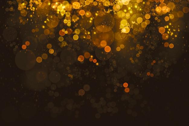 粒子の背景を持つ抽象ゴールドボケ