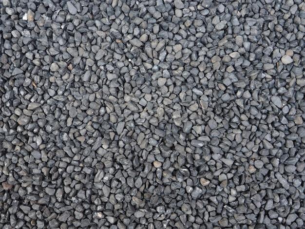 黒、灰色の石砂利のクローズアップの質感。