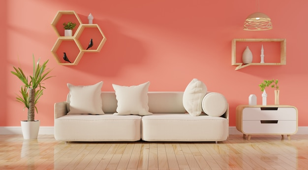 リビングコーラルカラーのソファーと緑の植物のあるモダンなリビングルームのインテリア