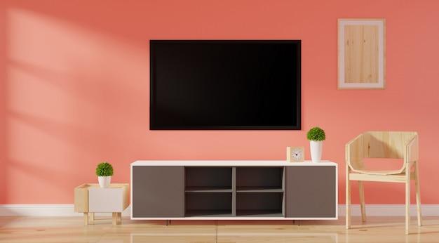 キャビネットテレビ、ポスターフレームスタンド、床に空白のキャンバス