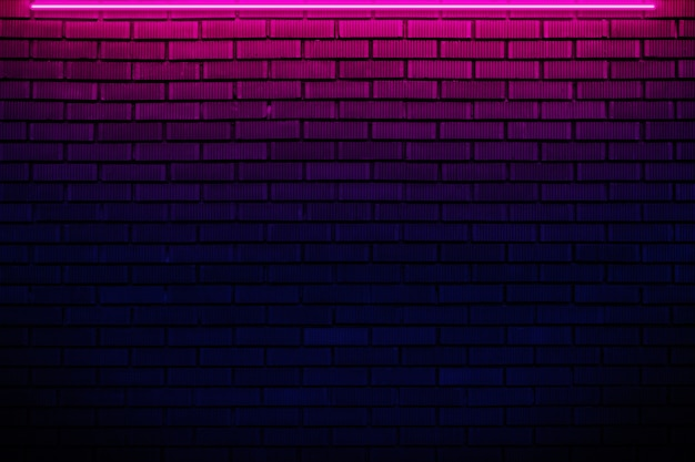ネオンの光でレンガの壁。