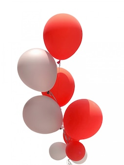白で隔離されるパーティーの装飾のための赤と白の風船のグループ