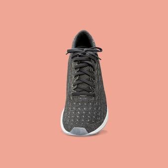クリッピングパスと美しいパステルカラーの背景に分離されたファッションランニングスニーカーの靴。