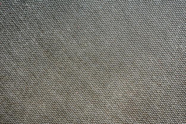 灰色の繰り返し図形の背景を持つ工業用テクスチャ