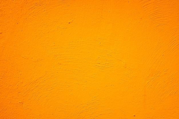 オレンジ色の塗られた壁の背景とテクスチャー。