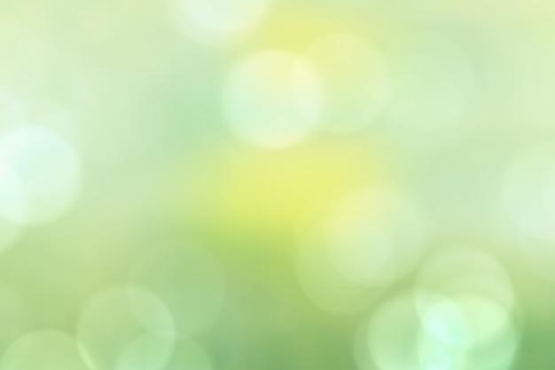 緑の自然光の背景、抽象的な美しい緑ボケ