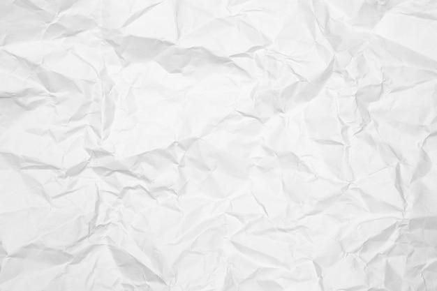 Скомканная предпосылка текстуры белой бумаги.