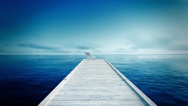 ホワイト・ラウンジャー&ブルー・シー&スカイ・トロピカル・ビーチの木製の桟橋