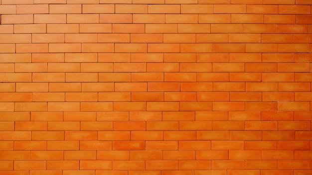 オレンジ色のレンガの壁、美しいテクスチャ背景。