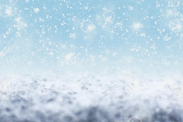 スノーフレークの背景に雪が降ってキラキラ