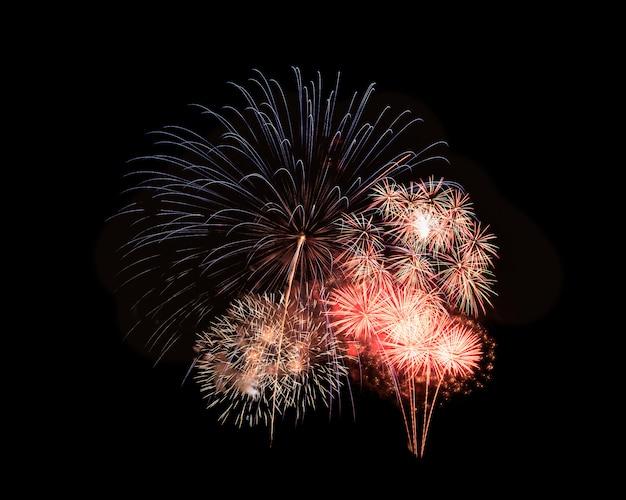 黒の背景に抽象的なお祭りカラフルな花火爆発