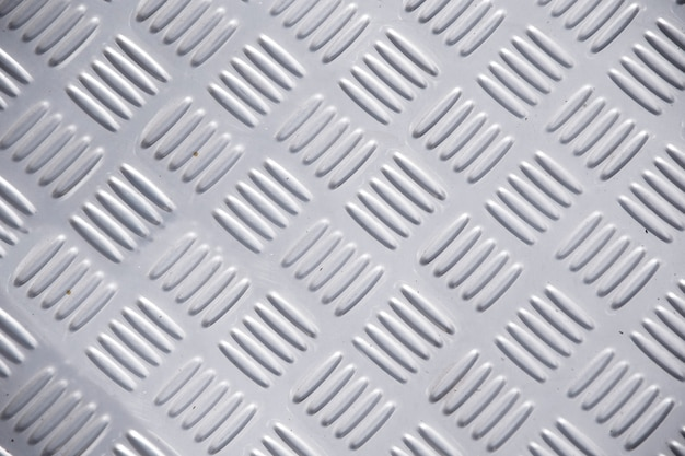 金属ダイヤモンドプレートの背景。シームレスな金属質感、鋼板の表。