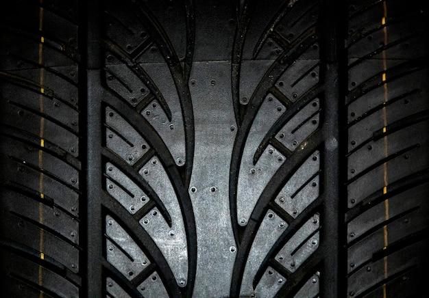 車のタイヤの背景、タイヤテクスチャのクローズアップの背景